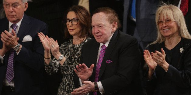WASHINGTON, DC - MARCH 03:  American billionaire casino mogul Sheldon Adelson (2nd R) and his wife Miriam Adelson (R) applaud