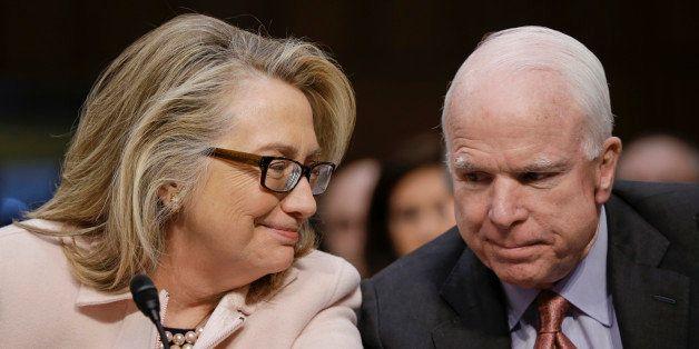 Secretary of State Hillary Rodham Clinton huddles with Sen. John McCain, R-Ariz., on Capitol Hill in Washington, Thursday, Ja