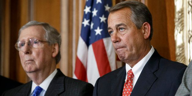 Speaker of the House John Boehner, R-Ohio, joined by Senate Majority Leader Mitch McConnell, R-Ky., left, leads a ceremony fo