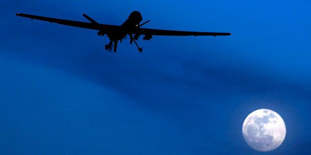 FILE - In this Jan. 31, 2010 file photo, an unmanned U.S. Predator drone flies over Kandahar Air Field, southern Afghanistan,