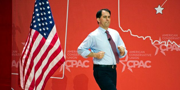 Wisconsin Gov. Scott Walker runs onstage to address the  Conservative Political Action Conference (CPAC) in National Harbor,