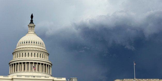Dark clouds are seen behind the U.S. Capitol as a storm moves through the area, Thursday, June 13, 2013 in Washington. (AP Ph