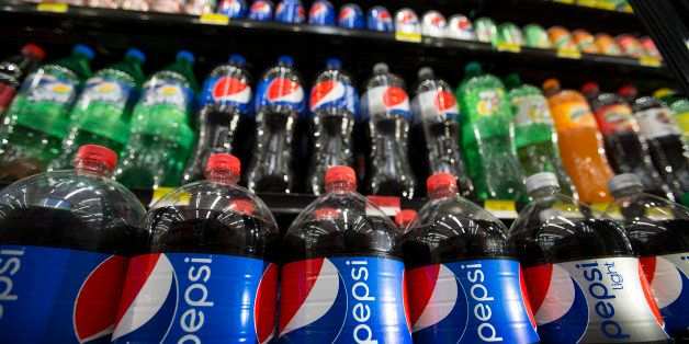 Bottles of PepsiCo Inc. Pepsi soft drinks sit on display at a store in Mexico City, Mexico, on Monday, July 22, 2013. PepsiCo