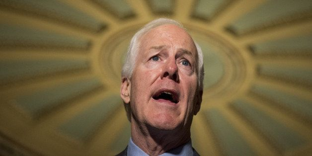 UNITED STATES - SEPTEMBER 9: Sen. John Cornyn, R-Texas, speaks to reporters in the Ohio Clock Corridor of the Capitol followi