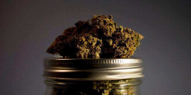 Marijuana strain on top of jar full of strains