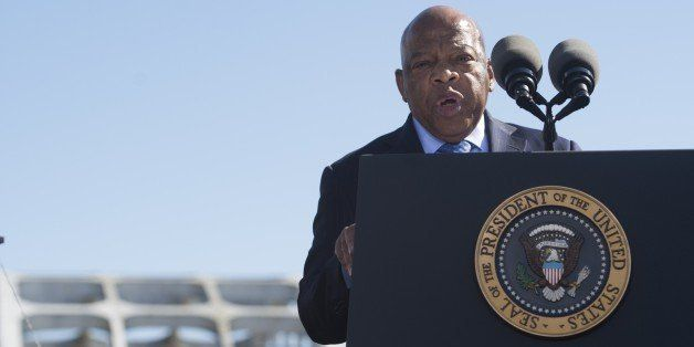 US Representative John Lewis, Democrat of Georgia and one of the original marchers, speaks during an event marking the 50th Anniversary of the Selma to Montgomery civil rights marches at the Edmund Pettus Bridgein Selma, Alabama, on March 7, 2015. US President Barack Obama rallied a new generation of Americans to the spirit of the civil rights struggle, warning their march for freedom 'is not yet finished.' In a forceful speech in Selma, Alabama on the 50th anniversary of the brutal repression of a peaceful protest, America's first black president denounced new attempts to restrict voting rights. AFP PHOTO/ SAUL LOEB (Photo credit should read SAUL LOEB/AFP/Getty Images)