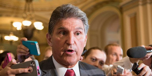 Sen. Joe Manchin, D-W.Va., talks to reporters on Capitol Hill in Washington, Tuesday, Sept. 10, 2013. as he leaves a closed-d