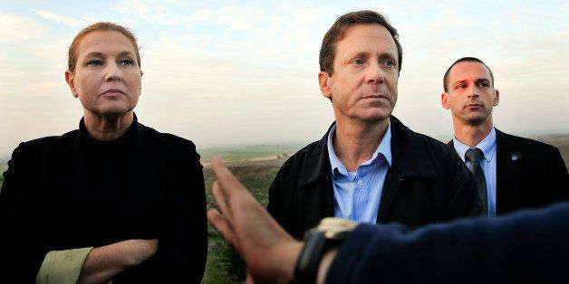 FILE - In this Thursday, Dec. 11, 2014 file photo, Israeli politicians Isaac Herzog, right, and Tzipi Livni listen during a t