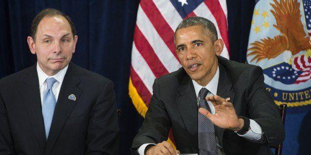 US President Barack Obama speaks alongside Secretary of Veterans Affairs Robert McDonald (L) following a briefing on US milit