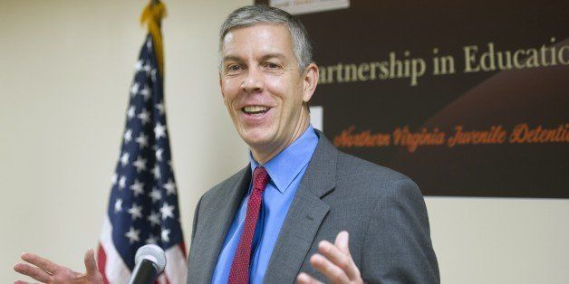 Education Secretary Arne Duncan speaks with reporters after he and Attorney General Eric Holder toured the Northern Virginia