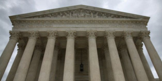 WASHINGTON, DC - AUGUST 20:  A guard stands on the steps of the Supreme Court Building, August 20, 2014 in Washington, DC. To