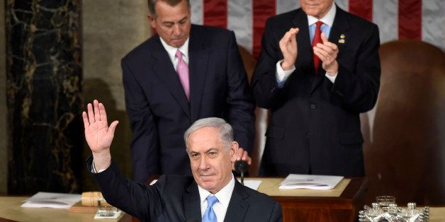 Israeli Prime Minister Benjamin Netanyahu waves as he speaks before a joint meeting of Congress on Capitol Hill in Washington