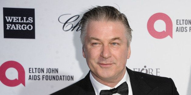 Alec Baldwin, left, and Hilaria Thomas arrive at the 87th Academy Awards - 2015 Elton John AIDS Foundation Oscar Party on Sun