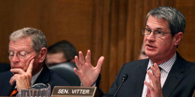 WASHINGTON, DC - JULY 23:  Sen. David Vitter (R-LA) (R) questions EPA Administrator Gina McCarthy while Sen. James Inhofe (R-