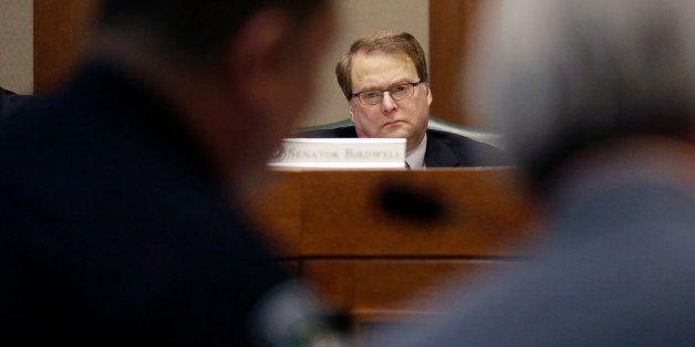 Texas Sen. Brian Birdwell, R-Granbury, listens to Austin police chief Art Acevedo give testimony during a hearing where lawma