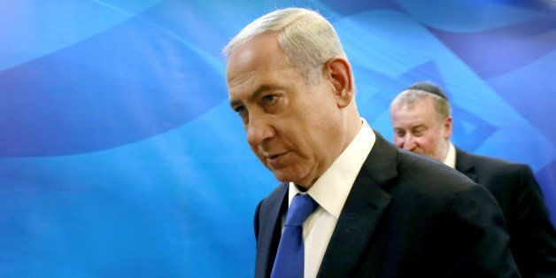 Israeli Prime Minister Benjamin Netanyahu arrives to chair the weekly cabinet meeting at his Jerusalem office, Sunday, March
