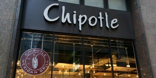 A Chipotle eatery in the Financial District of Manhattan NYC viewed from the outside looking in shows the interior design as