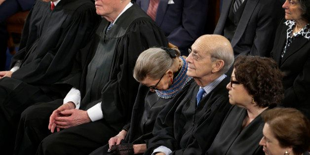 In this photo taken Jan. 20, 2015 members of the Supreme Court, including Justice Ruth Bader Ginsburg, center, rests during P