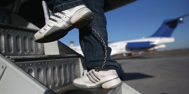 MESA, AZ - FEBRUARY 28:  A Honduran immigration detainee, his feet shackled and shoes laceless as a security precaution, boar