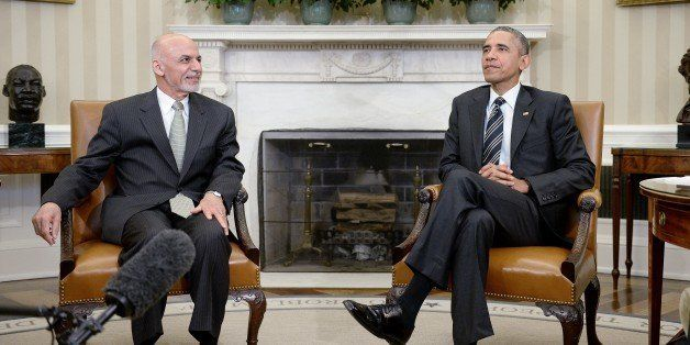 WASHINGTON, DC - MARCH 24: U.S. President Barack Obama poses with Afghan President Ghani during a restricted bilateral meetin