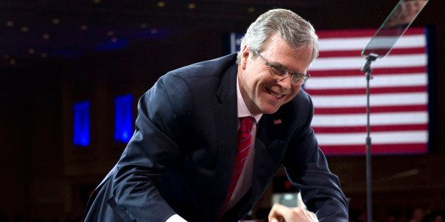 FILE - In this Feb. 27, 2015, file photo, former Florida Gov. Jeb Bush shakes hands with people in the audience after speakin
