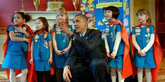 US President Barack Obama poses with girl scouts from Tulsa, Oklahoma during the 2015 White House Science Fair March 23, 2015