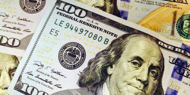 This Feb. 2, 2015, photo depicts a part of a U.S. $100 bill. Who gets what share of the federal budget pie has shifted over t