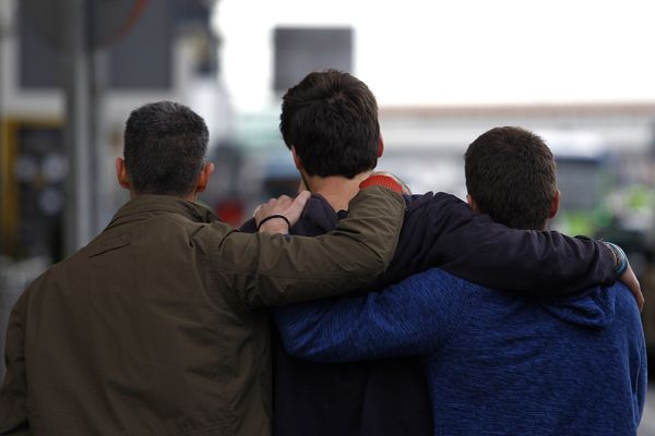 The family members of a victim clasp one another at Barcelona's El Prat airport on March 24, 2015.