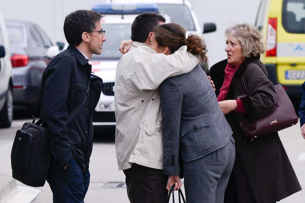 Relatives of passengers of the Germanwings plane that crashed in the French Alps arrive at Terminal 2 of the Barcelona El Pra