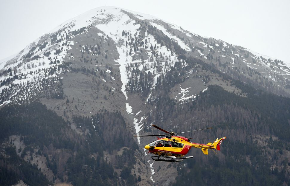 A helicopter of the French civil security services flies near Seyne, south-eastern France, on March 24, 2015, near the site w