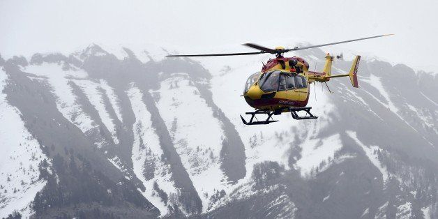A helicopter participates in rescue efforts on March 24, 2015 in the southeastern French town of Seyne after a German Airbus