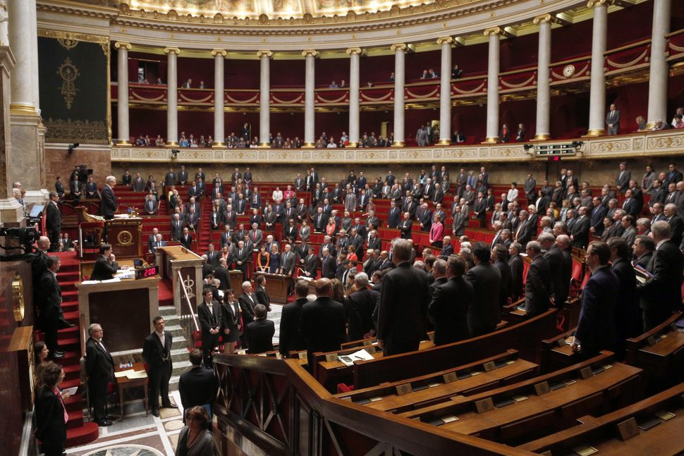 French MPs hold a minute of silence in memory of the 150 people who died in a Germanwings airliner crash during a session of
