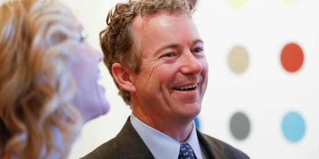Sen. Rand Paul (R-Ky.) laughs with his wife Kelley Ashby, left, as they arrive at a private reception for Britain's Prince