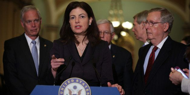 WASHINGTON, DC - MARCH 24:  U.S. Sen. Kelly Ayotte (R-NH) (2nd L) speaks to members of the media as Sen. Ron Johnson (R-WI) (