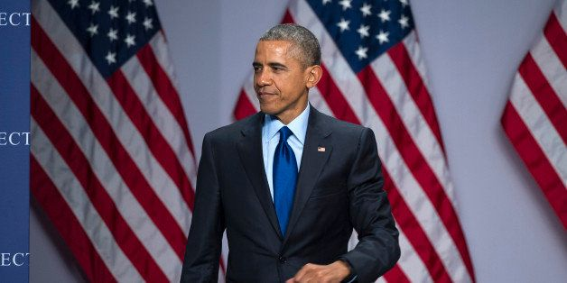 President Barack Obama arrives to speak at the SelectUSA Investment Summit, hosted by the Commerce Department, Monday, March 23, 2015, in National Harbor, Md. (AP Photo/Cliff Owen)