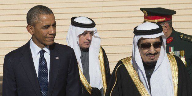 US President Barack Obama stands alongside Saudi new King Salman (R) after arriving on Air Force One at King Khalid Internati