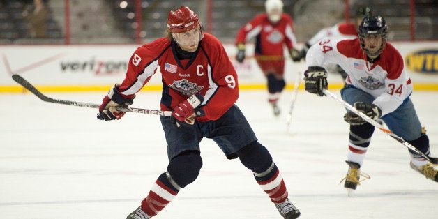 UNITED STATES   MARCH 4: Team Lawmakers captainTim Reagan takes a shot during the 4th Annual Congressional Hockey Challenge a