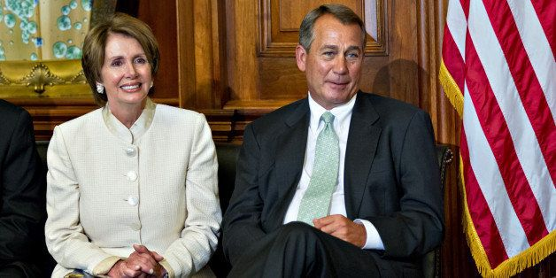 House Minority Leader Nancy Pelosi of Calif., left, and House Speaker John Boehner of Ohio, right, sit together during a cere