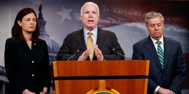 Senate Armed Service Committee Chairman Sen. John McCain, R-Ariz., center, accompanied by fellow committee members, Sen. Kell