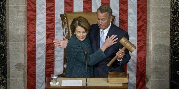 House Minority Leader Nancy Pelosi, D-CA, hands over the gavel to Speaker of the House John Boehner, R-OH, during a swearing-