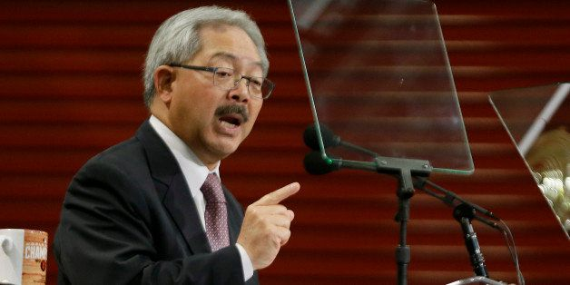 San Francisco Mayor Ed Lee gestures while delivering his State of the City address at a new facility of the Wholesale Produce