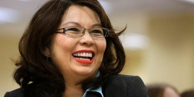 U.S. Rep. Tammy Duckworth, D-Ill., acknowledges applause from the crowd of supporters at the Illinois Democratic County Chair