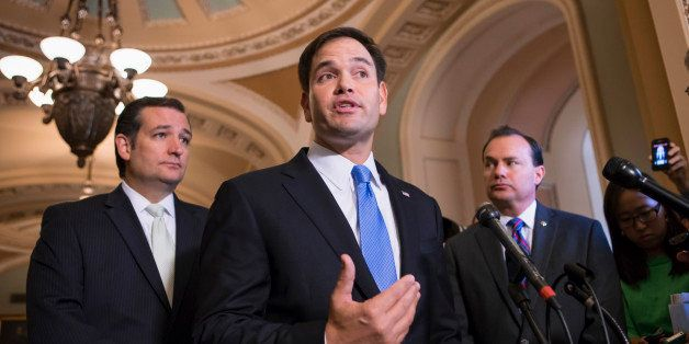 Sen. Marco Rubio, R-Fla., center, accompanied by Sen. Ted Cruz, R-Texas, left, and Sen. Mike Lee, R-Utah, speaks during a new
