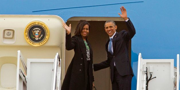 President Barack Obama and first lady Michelle Obama wave from Air Force One before departure at Andrews Air Force Base, Md.,