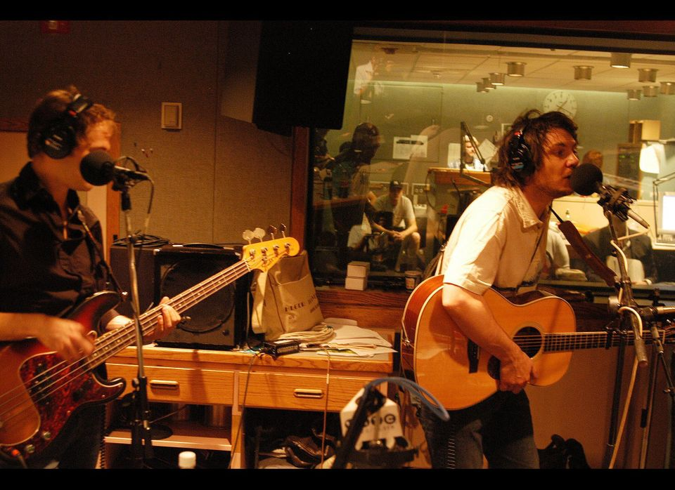 John Stirratt, left, and Jeff Tweedy, of the music group Wilco, perform in New York, June 17, 2004, prior to an NPR (National