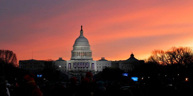The sun rises over Capitol Hill in Washington, Monday, Jan. 21,  2013, before the start of President Barack Obama's ceremonia
