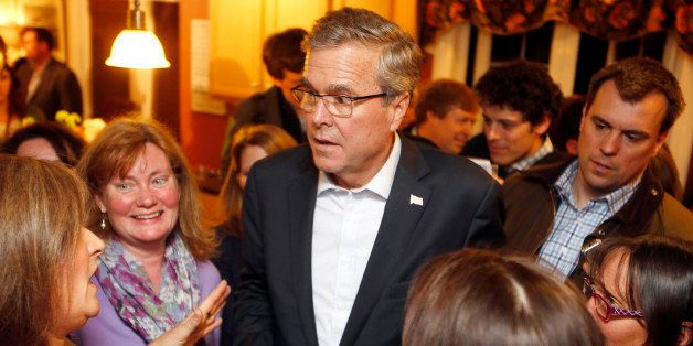 FILE - In this March 13, 2015 file photo, former Florida Gov. Jeb Bush speaks with area residents at a packed house party in