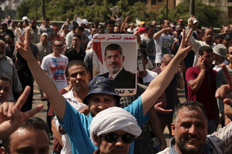 Supporters of ousted Egyptian President Mohammed Morsi march towards downtown Cairo from the Mohandeseen district of Cairo, E