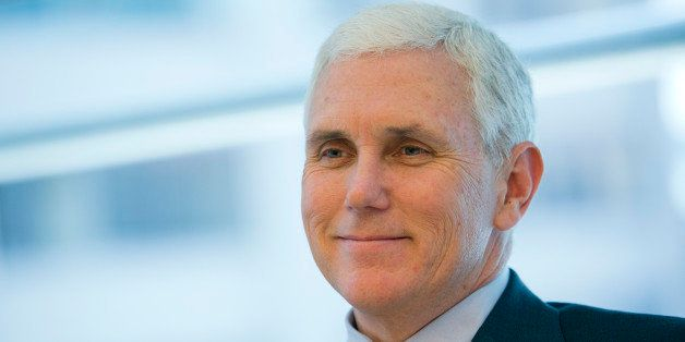 Michael 'Mike' Pence, governor of Indiana, smiles during an interview in New York, U.S., on Thursday, May 16, 2013. The large