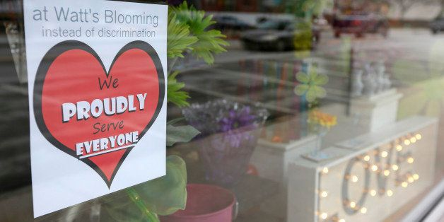 A window sign on a downtown Indianapolis florist, Wednesday, March 25, 2015, shows it's objection to the Religious Freedom bi